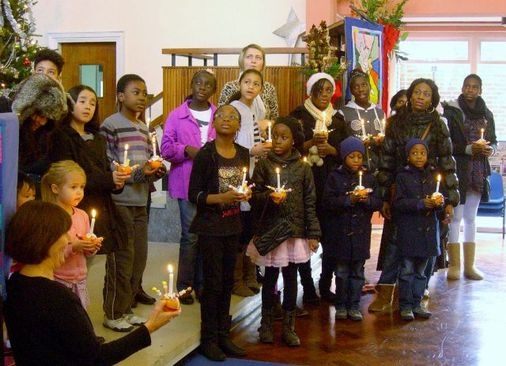 In church to sing our Christingle song