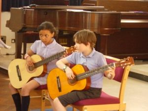 Two young guitarists at the Talent Show