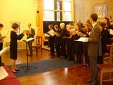 The choir with Sue conducting and soloists Mike and Chris