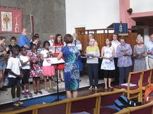 Singers and recorder players rehearsing